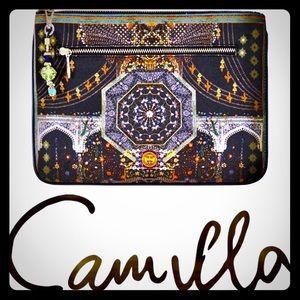Camilla Behind closes doors India clutch